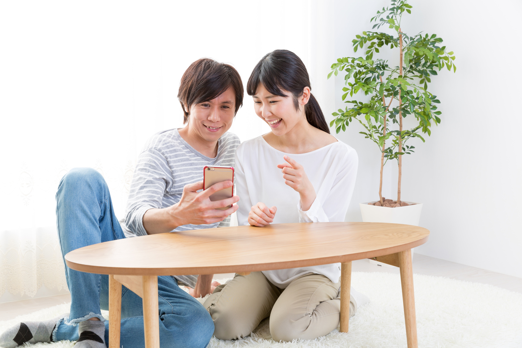 young asian couple using smart phone